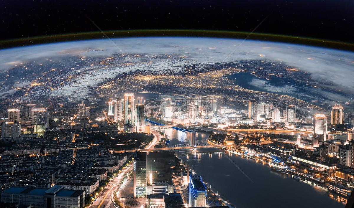 地球背景下的城市夜景图片